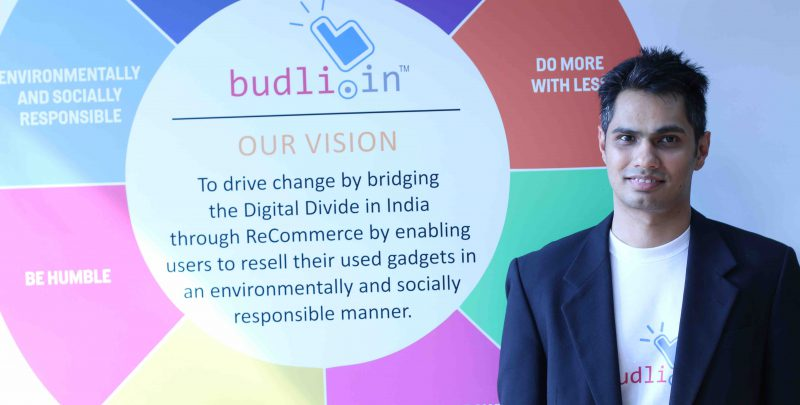 Entrepreneur Rohit Bagaria, Founder & CVO of Budli.in next to the Vision Board